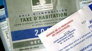 """Les demandes d'étalement de paiement de l'impôt sur le revenu et de la taxe d'habitation ont connu entre 10% et 20% d'augmentation en 2013, selon """"Le Figaro"""" et Europe 1. (MYCHELE DANIAU / AFP)"""
