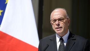 Le ministre de l'Intérieur, Bernard Cazeneuve, place Beauvau, samedi 22 août 2015. (MIGUEL MEDINA / AFP)