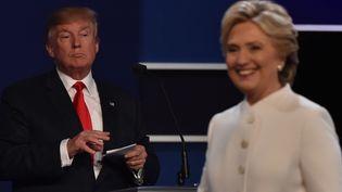 Donald Trump et Hillary Clinton, le 19 octobre à Las Vegas (Nevada, Etats-Unis). (PAUL J. RICHARDS / AFP)