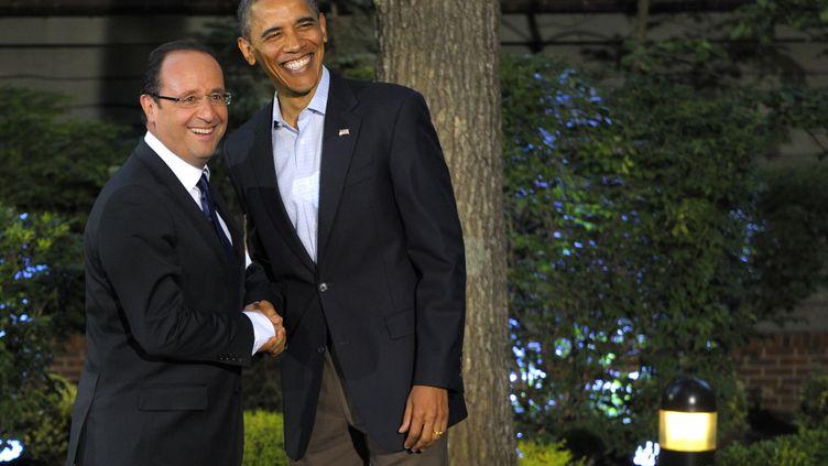 Les présidents François Hollande et Barack Obama lors du sommet du G8 à Camp David (Etats-Unis), le 18 mai 2012. (PHILIPPE WOJAZER / AFP)
