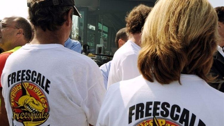 Grévistes de Freescale bloquant un dépôt de bus de Toulouse (23 septembre 2009) (© AFP / Pascal Pavani)