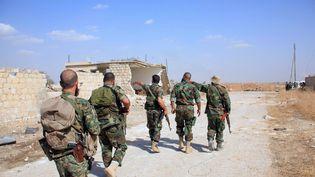 Des soldats de l'armée syrienne, autour d'Alep (Syrie), le 16 octobre 2015. (GEORGE OURFALIAN / AFP)