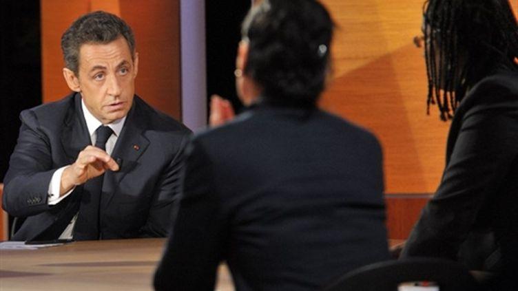 Nicolas Sarkozy sur la chaîne privée TF1 le 10 février 2011 (AFP - PHILIPPE WOJAZER)