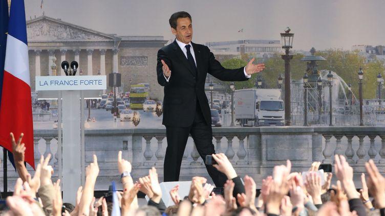 Nicolas Sarkozy lors d'un meeting avant l'élection présidentielle, place de la Concorde à Paris, le 15 avril 2012. (KENZO TRIBOUILLARD / AFP)