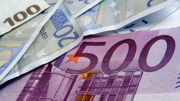 Les Français continuent d'investir en bourse.Mais ils ont vu les dividendes versés par les entreprises du CAC 40 baisser avec la crise. (BERNARD JAUBERT / ONLY FRANCE / AFP)
