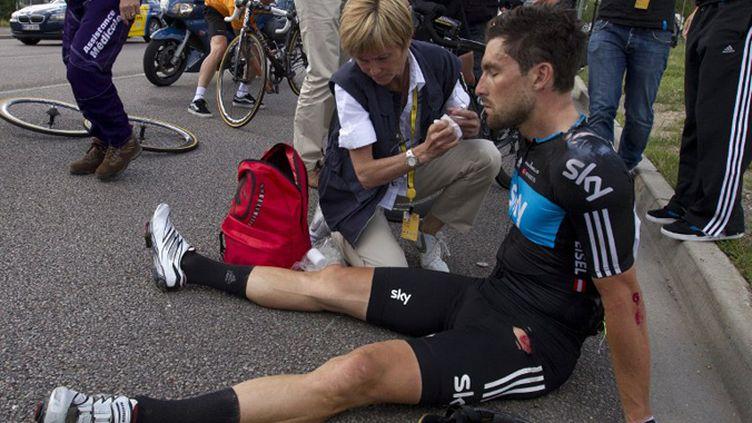 L'Autrichien Bernhard Eisel (Sky) après sa chute à Rouen lors de la 4e étape du Tour de France (JOEL SAGET / POOL)