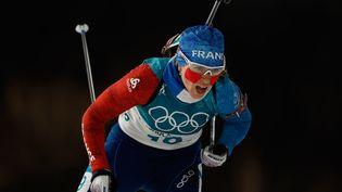 La Française Anaïs Bescond lors de l'épreuve de la poursuite du biathlon aux Jeux olympiques de Pyeongchang (Corée du Sud), le 12 février 2018. (ODD ANDERSEN / AFP)
