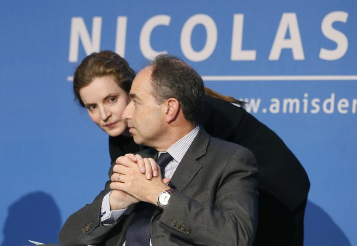 """NKM et Jean-François Copé lors d'une réunion des """"Amis de Nicolas Sarkozy"""", le 20 février 2013 à Paris. (PATRICK KOVARIK / AFP)"""