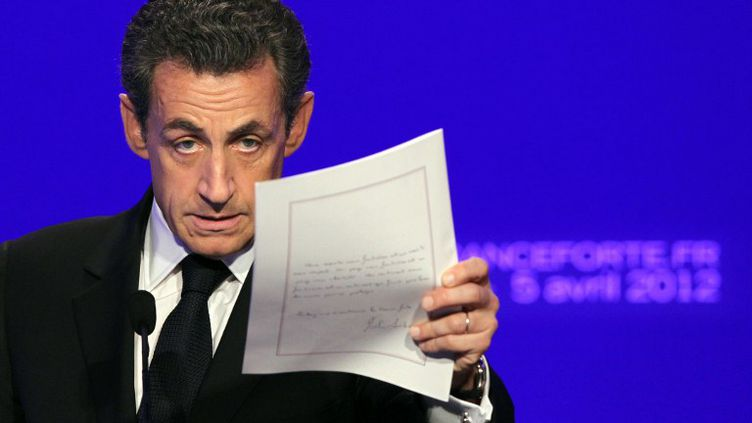 Nicolas Sarkozy lors de la présentation de son programme, le 5 avril 2012 à Paris. (KENZO TRIBOUILLARD / AFP)