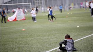 Des enfants font du sport à Paris en septembre 2017. (LUC NOBOUT / IP3 PRESS/ MAXPPP)
