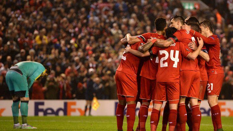 Les Reds célèbrent leur victoire. (OLI SCARFF / AFP)
