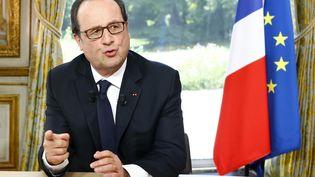 François Hollande, lors de l'interview accordée à TF1 et France 2, le14 juillet 2016. (FRANCOIS MORI / POOL)
