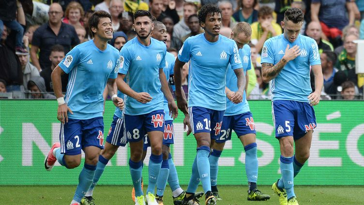 Les joueurs de l'Olympique de Marseille. (JEAN-SEBASTIEN EVRARD / AFP)