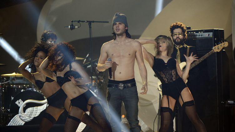 Le chanteur Aurélien Cotentin, plus connu comme Orelsan, lors des Victoires de la Musique, le 8 février 2013, au Zenith, à Paris. (BERTRAND GUAY / AFP)