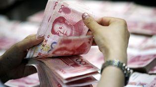 La Chine a de nouveau dévalué sa monnaie, le mercredi 12 août 2015. (XIE ZHENGYI / IMAGINECHINA)