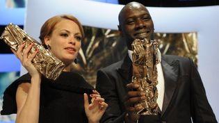 """Bérénice Béjo (""""The Artist"""") et Homar Sy (""""Intouchables"""") César Meileur actrice et Meilleur acteur aux Césars 2012  (ERIC FEFERBERG)"""