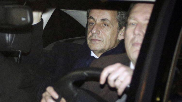 Nicolas Sarkozy, le 16 février 2016, à sa sortie du pôle financier, où il a été mis en examen pour financement illégal de campagne électorale. (GEOFFROY VAN DER HASSELT / AFP)