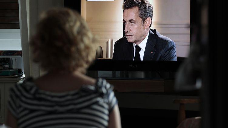 L'ancien président de la République Nicolas Sarkozy intervient sur TF1 et Europe 1 après sa mise en examen, mercredi 2 juillet 2014. (CHARLY TRIBALLEAU / AFP)