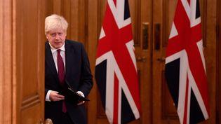 Le Premier ministre britannique, Boris Johnson, lors d'une conférence de presse à Londres, le 19 décembre 2020. (TOBY MELVILLE / POOL / AFP)