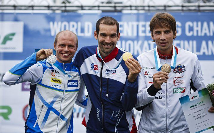 Le Français Thierry Gueorgiou remporte la médaille d'or au championnat du monde de course d'orientation, àSotkamo (Finlande) le 9 juillet 2013. (LEHTIKUVA LEHTIKUVA / REUTERS)