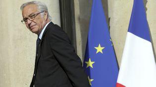 (François Rebsamen, le ministre du Travail, bat sa coulpe © REUTERS/Philippe Wojazer)