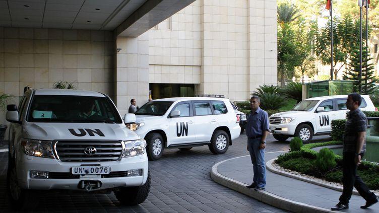 Les vingt inspecteurs de l'Organisation pour l'interdiction des armes chimiques (OIAC) sont arrivés à leur hôtel à Damas (Syrie), mardi 1er octobre 2013. (LOUAI BESHARA / AFP)