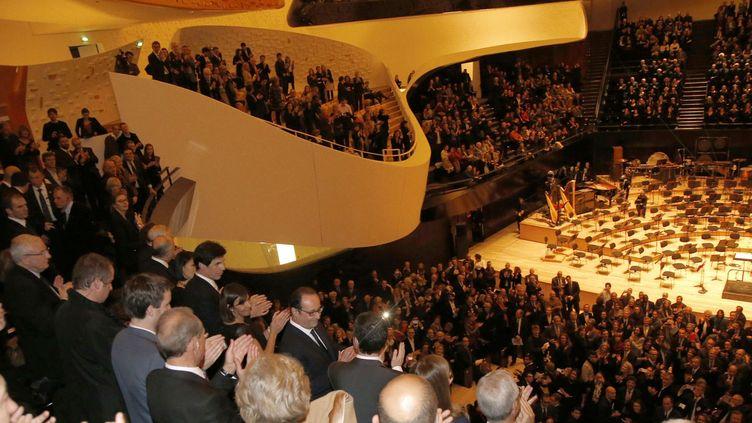 François Hollande ovationné lors de l'inauguration de la Philharmonie, le 14 janvier 2015.  (Charles Platiau/AP/SIPA)