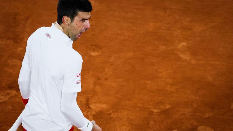 Novak Djokovic crie sa rage. (THOMAS SAMSON / AFP)