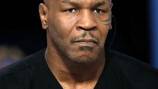 """Mike Tyson, lors de sa participation au """"Grand journal"""" de la chaîne Canal+, le 9 décembre à Paris. (THOMAS SAMSON / AFP)"""