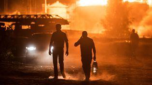 Plusieurs pompiers sont morts dans l'incendie gigantesque d'un dépôt pétrolier près de Kiev (Ukraine), qui s'est déclenché le 8 juin 2015. (RIA NOVOSTI / AFP)