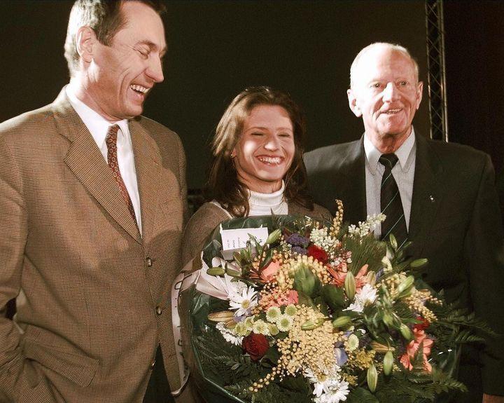 Jean-Marie Bockel, Roxana Maracineanu et Laurent Horter, le 25 janvier 1998 à Mulhouse. (GERARD CERLES / AFP)