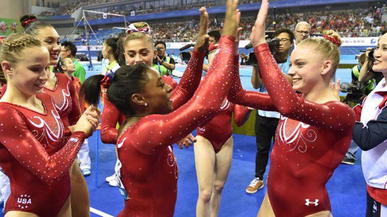 Les gymnastes américaines heureuses (KAZUHIRO NOGI / AFP)