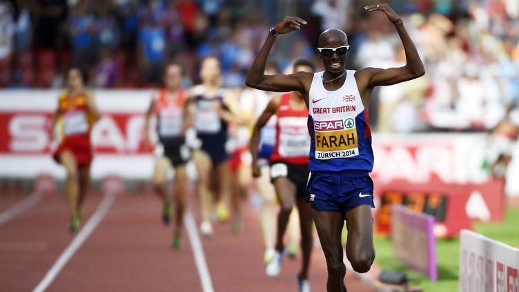Mo Farah a réalisé le double 5000m-10000m  (OLIVIER MORIN / AFP)