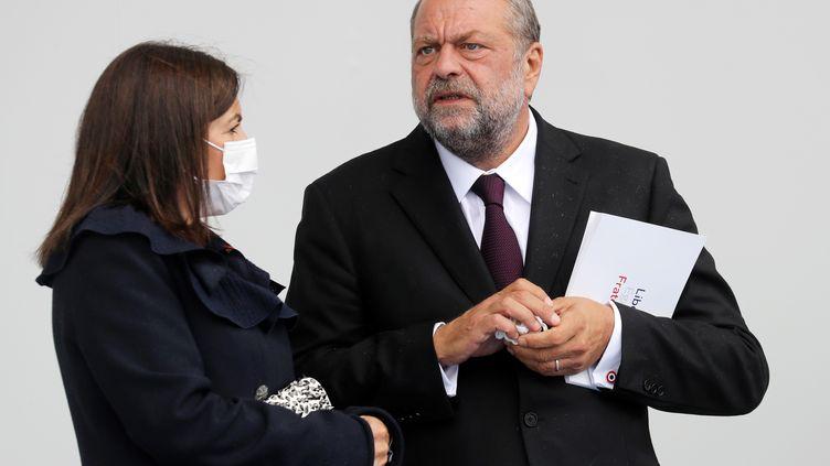 Le ministre de la Justice, Eric Dupond-Moretti, et la maire de Paris, Anne Hidalgo, à l'occasion des cérémonies du 14-Juillet 2020, à Paris. (LUDOVIC MARIN / AFP)