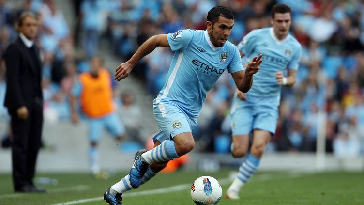 Carlos Tevez sous le maillot de Manchester City, le 10 septembre 2011, à Manchester (Royaume-Uni). (ADRIAN DENNIS / AFP)