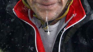 Lance Armstrong, lors d'une étape pluvieuse du Tour de Suisse, le 18 juin 2010. (CHRISTIAN HARTMANN / REUTERS)