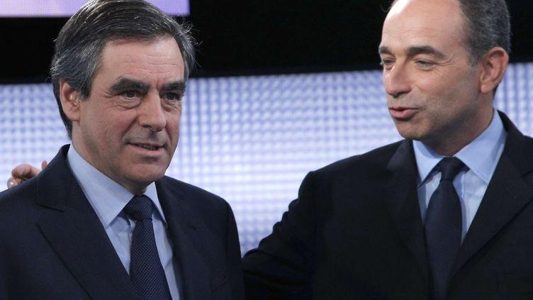 """François Fillon et Jean-François Copé, le 25 octobre 2012 sur le plateau de """"Des paroles et des actes"""", sur France 2. (CHRISTOPHE ENA / AP / SIPA)"""