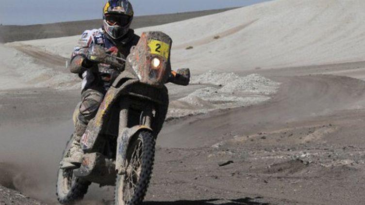 Cyril Desprès (KTM) maculé de boue (PHILIPPE DESMAZES / AFP)