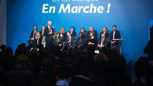 Stanislas Guérini, délégué général de La République en marche, debout, devant plusieurs membres du parti, dont Aurore Bergé et Pierre Person, le 24 janvier 2019 lors d'une conférence à Paris. (MICHEL STOUPAK / NURPHOTO / AFP)