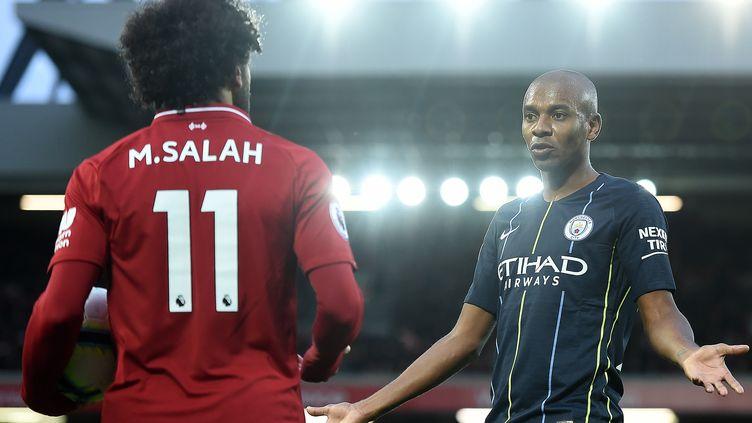 Mohamed Salah (Liverpool) face à Fernandinho (Manchester City) (PAUL ELLIS / AFP)