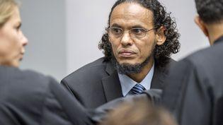 Ahmad Al-Faqi Al-Mahdi, jugé pour avoir détruitneuf des mausolées de Tombouctou (Mali), au premier jour de son procès à La Haye (Pays-Bas), le 22 août 2016. (PATRICK POST / ANP / AFP)