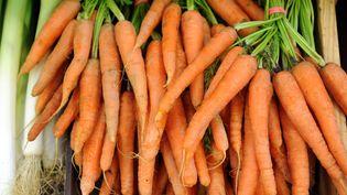 Le carotène est un pigment orange présent dans les carottes et d'autres végétaux colorés. Ilest converti par le foie en vitamine A, essentielle au bon fonctionnement de notre organisme. (FRED TANNEAU / AFP)