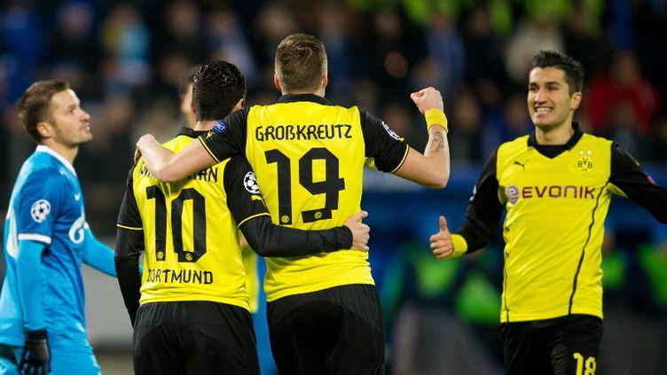 La joie des joueurs de Dortmund (ALEX GOTTSCHALK / AFP)