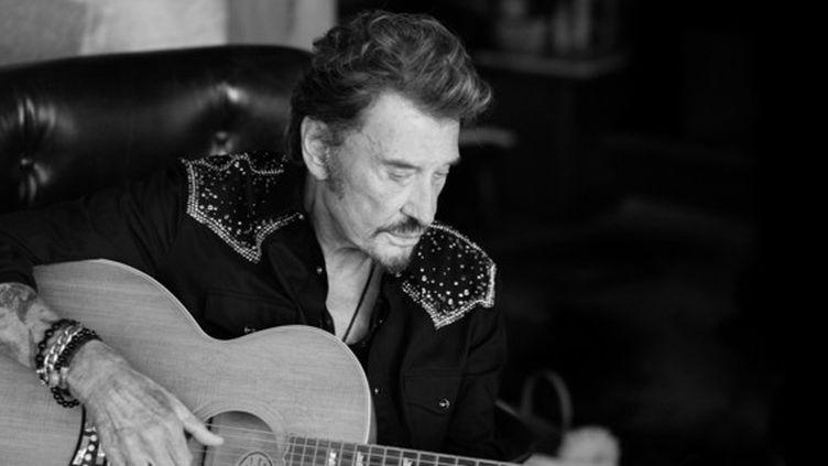 """Johnny Hallyday dans le livret de l'album """"Mon pays c'est l'amour"""". (MATHIEU CESAR)"""