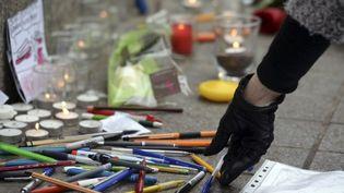 Hommage aux victimes le 8 janvier à Strasbourg  (PATRICK HERTZOG / AFP)