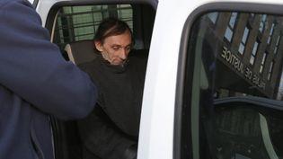 Eric F. quitte le palais de justice de Briey (Meurthe-et-Moselle), le 23 février 2016. (FRED MARVAUX / AFP)