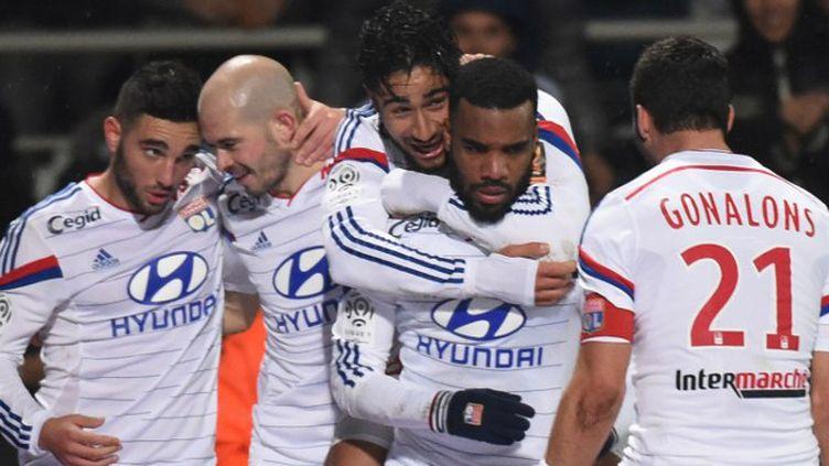 Alexandre Lacazette a marqué le but de la victoire dans le temps additionnel. (PHILIPPE DESMAZES / AFP)