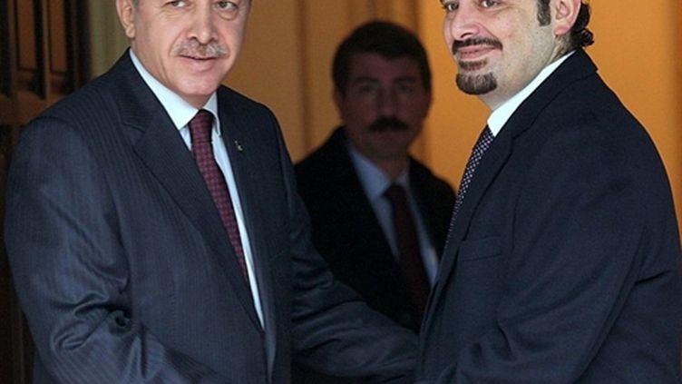 Le Premier ministre turc Recep Tayyip Erdogan (g) et son homologue libanais Saad Hariri à Ankara le 14 janvier 2011 (AFP / Adem Altan)