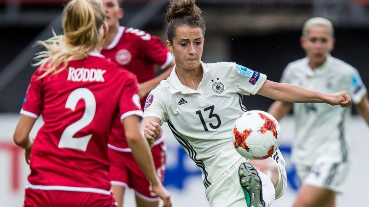 Les joueuses danoises et allemandes au duel à Rotterdam (Pays-Bas). (KAY INT VEEN / ANP)