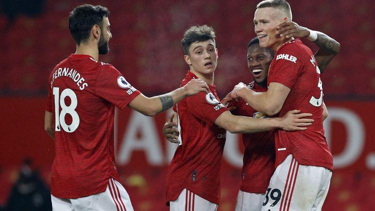Avec cette victoire, Manchester United revient à hauteur de City en tête du championnat. (PHIL NOBLE / POOL)